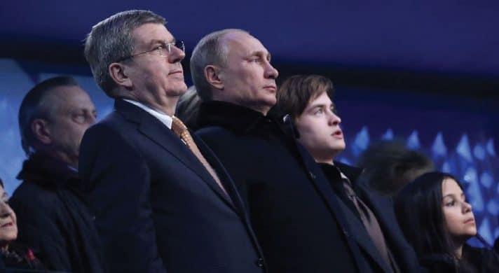 פוטין ותומאס באך בטקס הפתיחה של אולימפיאדת החורף בסוצ'י, פברואר 2014 // צילום: John Berry, Getty Images IL