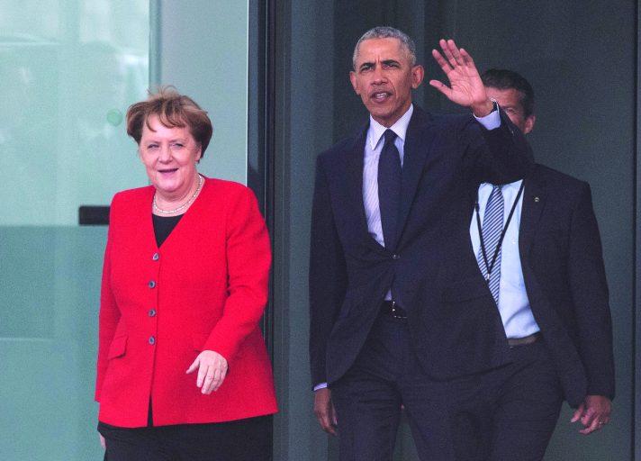 אובמה ומרקל, השנה // צילום: John Macdougalla, AFP, Getty Images IL