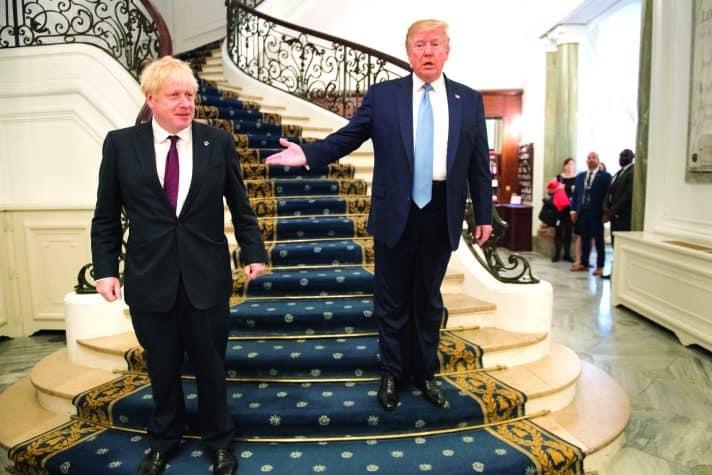 טראמפ וג'ונסון // צילום: Stefan Rousseau - Pool, Getty Images IL