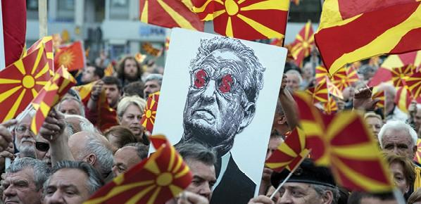כרזה נגד סורוס בהפגנה באלבניה צילום Robert AtanasovskI, AFP via Getty Images IL
