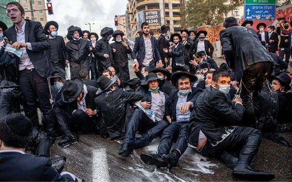 מפגינים בירושלים. התיקון של החרדים הוא הפטריוטיזם הלאומני // צילום: אוהד צויגנברג, ׳הארץ׳