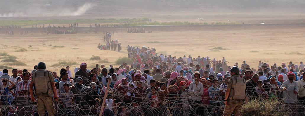 פליטים סורים על גבול טורקיה צילום Halil Fidan, Anadolu Agency, Getty Images